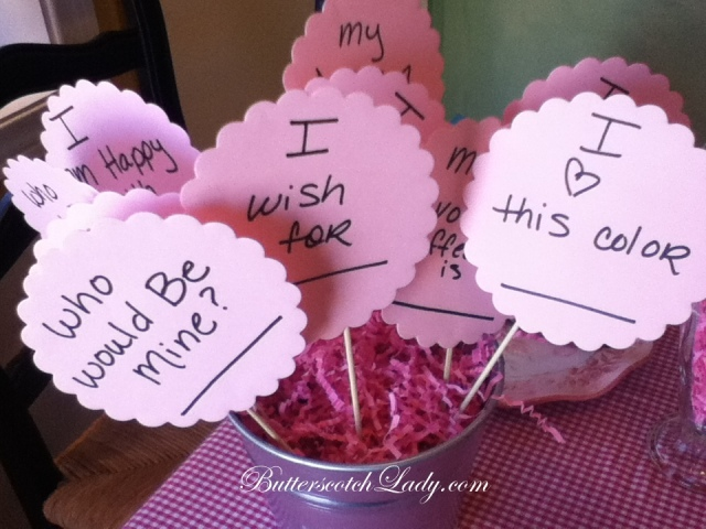 Die cuts from Staple's taped onto wood skewers with questions for the girls to ask one another.  A BIG HIT!