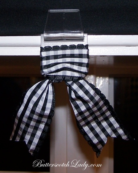 {I added ribbon to the plastic pulls to the blackout shades from Ikea.  Ribbon makes anything look fabulous!}